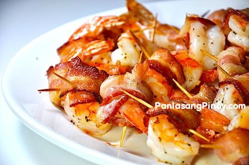 Bacon Wrapped Shrimp is an easy shrimp appetizer recipe that tastes really good. The process involves marinating the shrimp and then wrapping it in bacon strips before baking. If you are one of those who love to grill, you may opt to grill the shrimp instead.  I used the packaged large raw shrimp for this recipe. I usually purchase it when I need