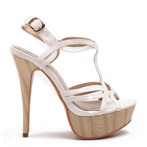White high heeled sandals with patent straps, slim wooden heel, wooden platform and adjustable gold buckle.