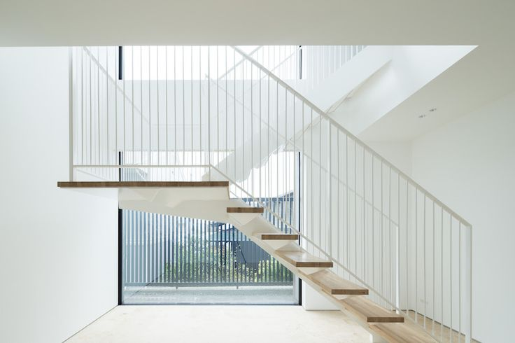 Bright and open #modern interior of a #Japanese home with a #monolith inspired exterior design