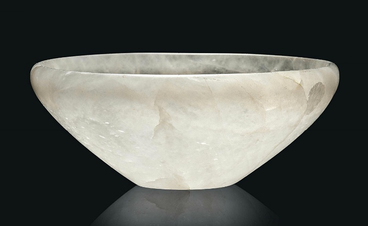 AN EGYPTIAN ROCK CRYSTAL BOWL EARLY DYNASTIC, DYNASTY I, CIRCA 3000-2750 B.C. With flaring convex sides and inward-folded rim, on a flat base, the interior with circular countersunk recess 4¾ in. (12 cm.) diam., 1 7/8 in. (4.8 cm.) high