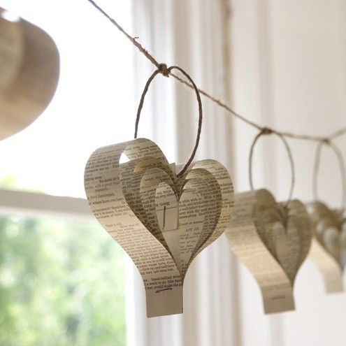BIG GARLAND! Hanging Hearts  Cut strips of paper from books, hymns, or colored paper and staple at one end. Then flip the strips inside out and staple again. Now you have CUTE hearts to hang!