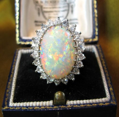 opal engagement ring...I would LOVE to have this as my engagement ring. So unique and I have given up on the need for a diamond. How about opal? I LOVE opal, especially this one. Wink wink.