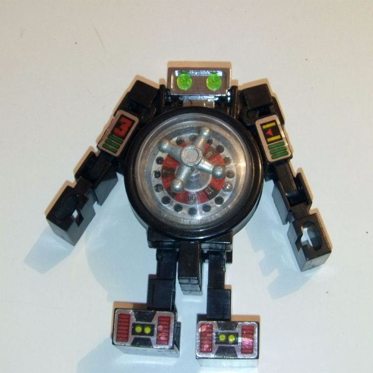 ITEM Pretty cool Transformers style Roulette Table Machine its a unbranded toy just says made in China DISCRIPTION Good hard to find Toy SIZE APPROX
