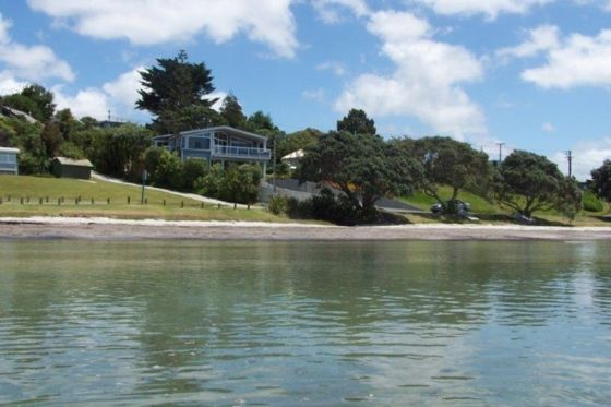Snells beach waterfront apartment. Two Queen beds. photo of accommodation from out at sea