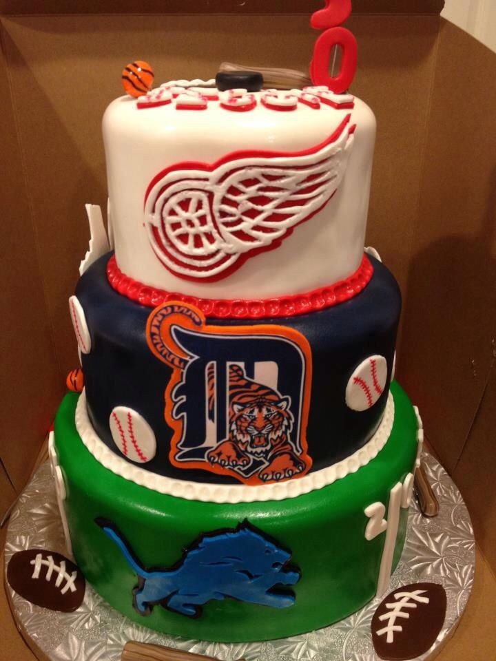 Sports theme wedding cake with detroit tigers, lions and red wings!!!