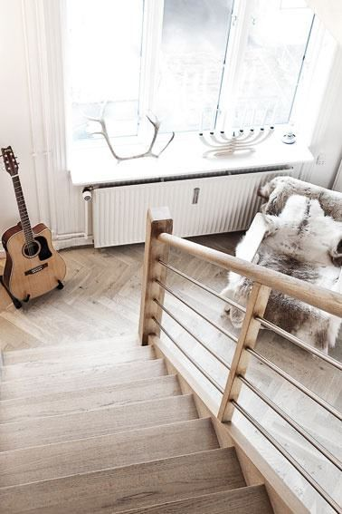 love the banister, stairs, guitar, antlers, chair, everything.