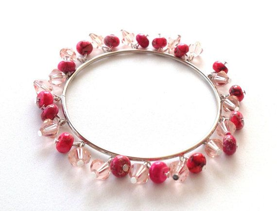 I love how dainty and feminine this bangle is! I was really going for a girly look, so I created it using semi transparent pink crystals and pink agate beads. This bangle jingles with your every move and would look great paired with almost anything! The bangle measures almost 3