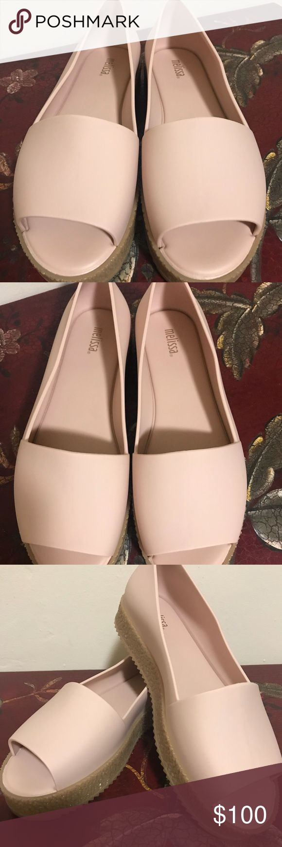 Melissa Melissa shoes, brand new with the shoe bag. I bought this when we visited Brazil. The shoes have their own fragrance that will last long. The Melissa brand is popular in Brazil because of the fragrances added to the shoes. Melissa Shoes Flats & Loafers