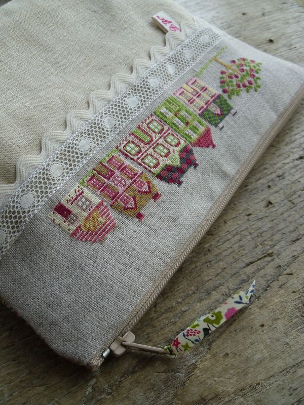 Lovely row of cross-stitched houses - a surprising part of a pouch. Zakka Style, with the linen, lace and colors