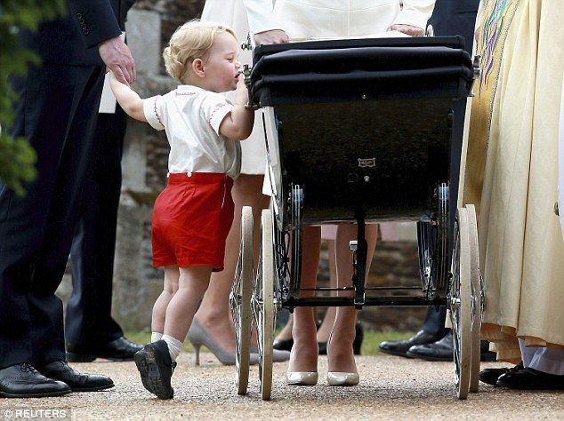 Prince George teetered on his tip toes to check on Princess Charlotte in her pram after her christening at Sandringham