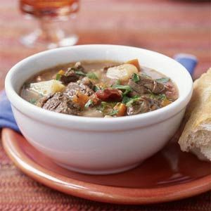 Hearty Beef and Potato Stew Recipe | MyRecipes.com - This one-dish meal is a simple, make-ahead family favorite. Make the beef stew the night before, cool to room temperature, and refrigerate; reheat single servings in the microwave or a slow cooker set on HIGH the next day. To save prep time, use bottled peeled fresh garlic.