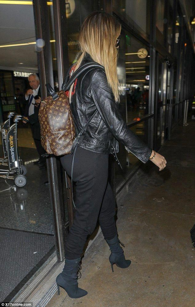 288941afe98 Go handsfree like Khloe in her Louis Vuitton  DailyMail Click  Visit  to buy