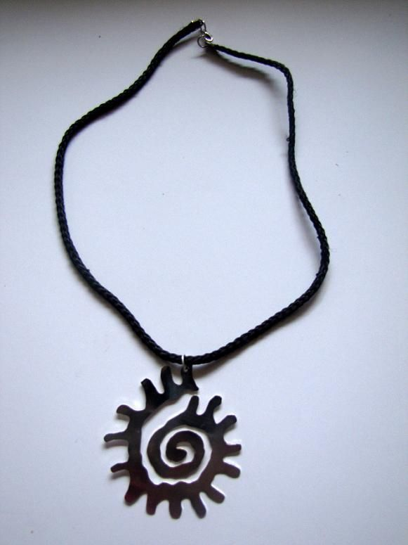 In the form of sun, silver plated, is made by Berrin Duma