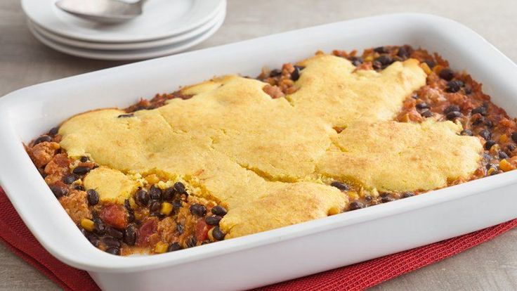 Welcome family to the dinner table with a homey casserole of turkey, beans and salsa topped with a tasty cornbread topper.