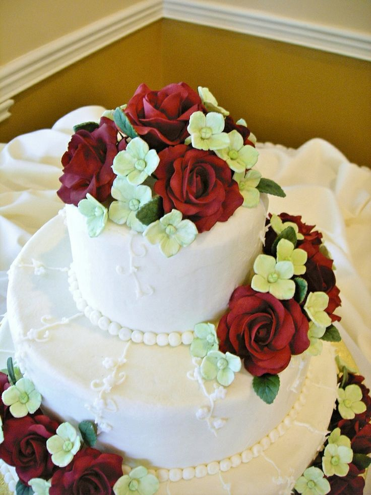 I made gumpaste roses and hydrangeas to top this wedding cake