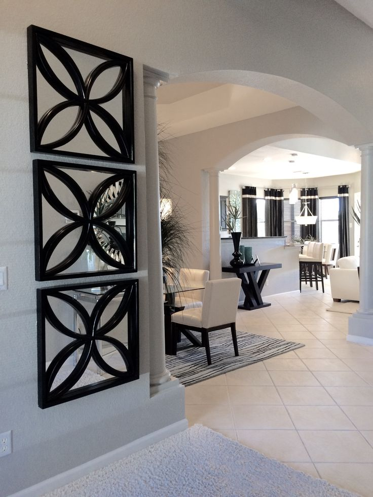 Florida tiled Entry with stacked floral motif custom mirrors. Interiors designed by Fresco Interiors DesignGroup Inc.