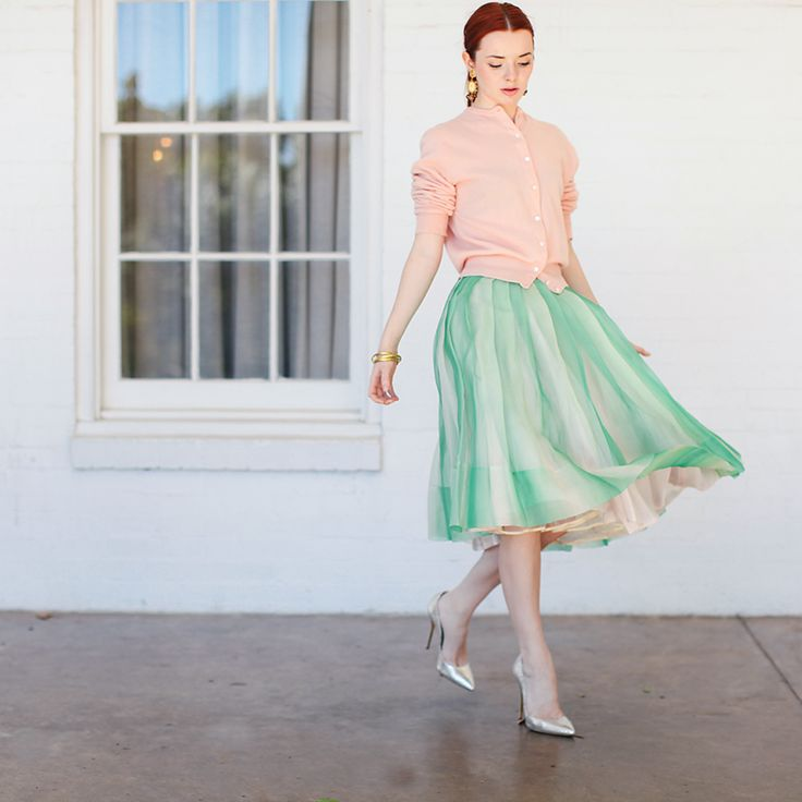 Jane Aldridge of Sea of Shoes showing us her 50s Skirt + Cashmere Sweater with Dolce and Gabbana earrings and Oscar de la Renta pumps.