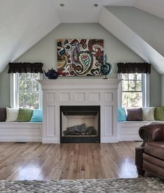 living rooms with windows beside fireplace - benches