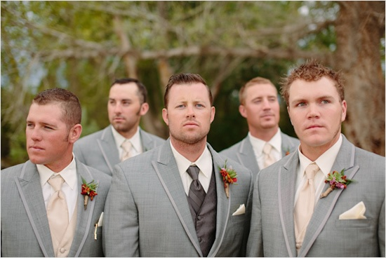 Tuxedo idea with the groom in blush/pink and groomsmen in champaign