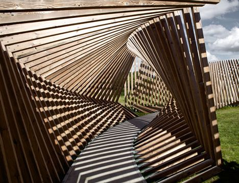Visitors to this installation are invited to walk through a contorted loop of timber while listening to the sounds of their voices and footsteps played back to them