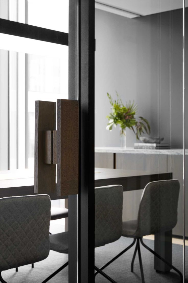 Sleek office workspace design featuring Designer Doorware rectangular Timber Pull Handle