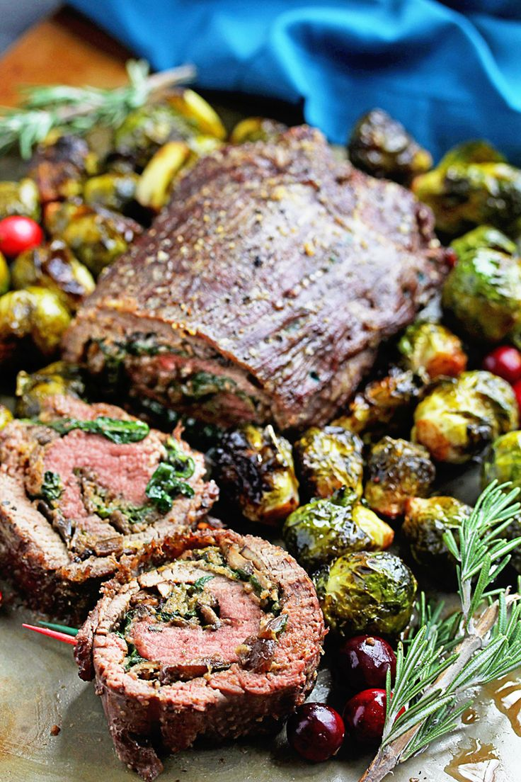 Stuffed Flank Steak Recipe and Roasted Brussel Sprouts Recipe - A steak stuffed with mushrooms, spinach, etc served with brussel sprouts perfectly roasted.