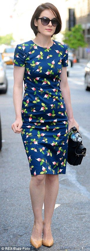 Ladylike chic: The 31-year-old actress looked the picture of effortless elegance in a pretty navy blue floral tea dress and nude heels as sh...
