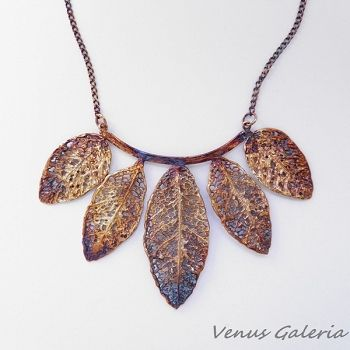 Silver necklace- with five leafs