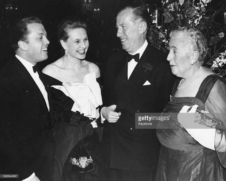 Author Agatha Christie (right) talking to impresario Peter Saunders (centre), actor Richard Attenborough and his wife Sheila Sim, at a party to celebrate her play 'The Mousetrap' at the Savoy Hotel, London, April 1958