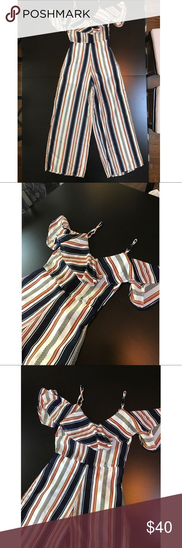 NWT Striped Jumpsuit New with tags! Boutique cold shoulder striped jumpsuit with adjustable straps! Size women's XS. Lined with shorts. Pants Jumpsuits & Rompers