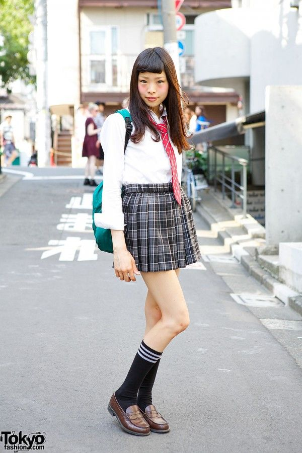 This is Rina, a 17-year-old Japanese student recently met in Harajuku. Rina is wearing a very cute Japanese school uniform with a pleated plaid skirt, white shirt and red tie. Her backpack is green and her brown loafers are worn with long socks. (Tokyo Fashion, 2014)