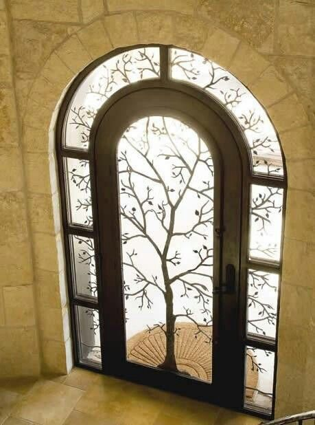 Lord Of The Rings themed door. White Tree of Gondor or Moria entrance glass door to study/office.  Pic not actual, reference only.