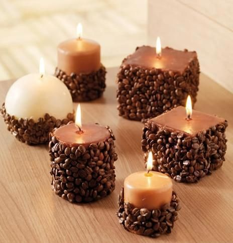 Put glue on the candle and roll in coffee beans - I bet this smells wonderful!