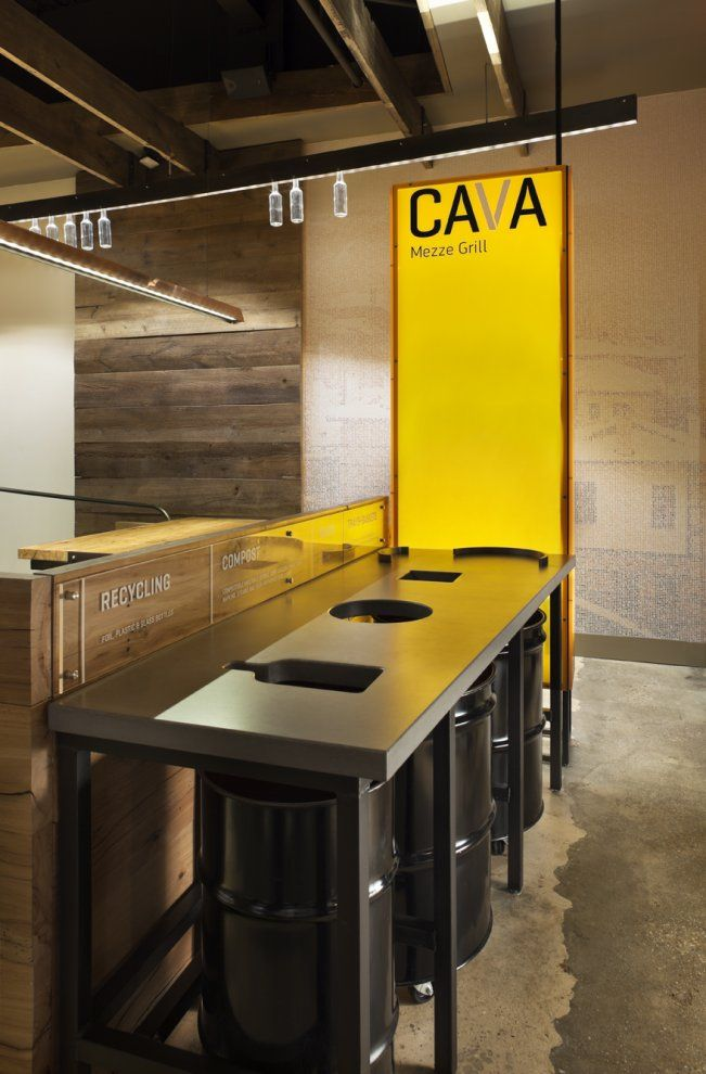 Pictures - Cava Mezze Grill - Architizer :: countertop cut-outs recycling idea-glass, paper and i'm assuming plastic, corresponds to the right trash can underneath.