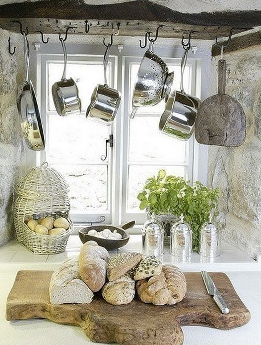 To create your French country kitchen, install hooks and hang pots and pans in the open - no more hiding them away. Store coffee and tea in Brissi's elegant silver caddies (£34). Pick up a variety of fresh bread at the market and display on a rustic wooden cutting board. Basil and other herbs in the window sill will add a finishing touch and rich fragrance, reminiscent of those hot summers in Provence.