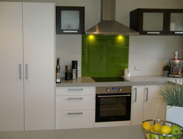 Resene Half Tea walls used with Resene Pacifika splashback livens up this kitchen.