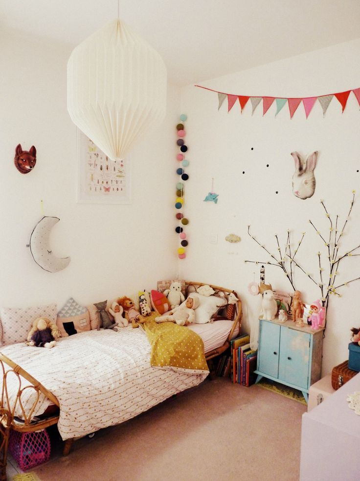 Kids room. Love the poms in the corner and the doll of course!