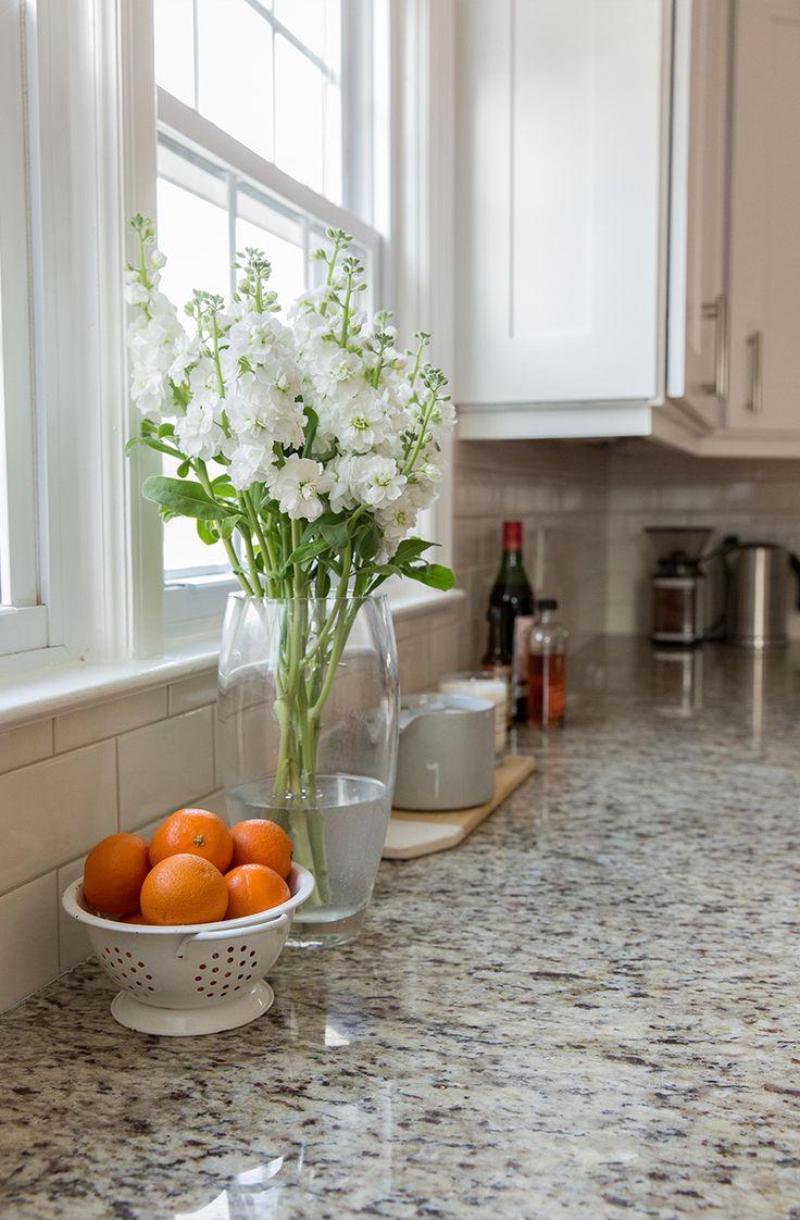 White cabinets, giallo ornamental granite, white/cream/light grey subway tile
