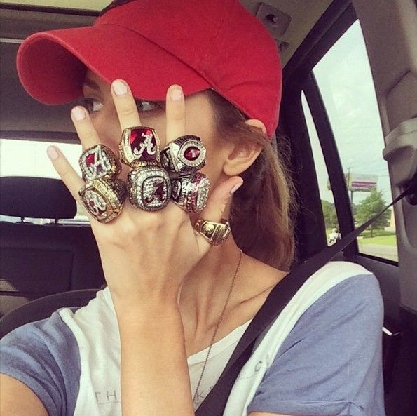 Former Miss Alabama Katherine Webb decided to post this picture of herself with a number of former Alabama Crimson Tide quarterback AJ McCarron's rings from his very successful college career.   McCarron received all of those rings thanks to three national championships, two SEC titles and one Capital One Bowl.  Must kill Auburn folks since she is an alum.
