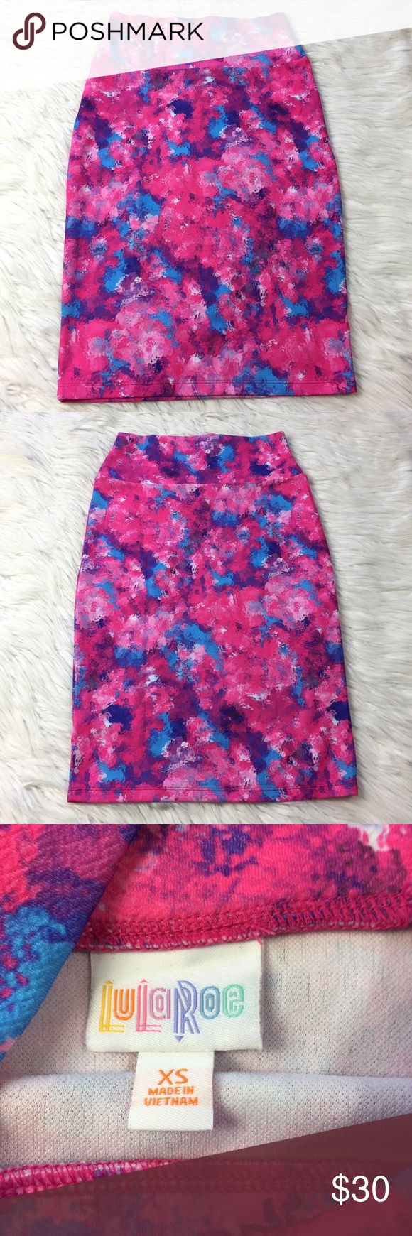 """•• LuLaRoe Cassie Skirt • Bright Watercolor Floral Size: XS (Fit's Women's 2-4)  LuLaRoe Cassie in excellent condition overall. So comfortable. The thicker waist band makes it very comfortable and flattering to many body shapes. Cassie's are perfect for casual activities, the office, get togethers, date night, girls not out, shopping, vacations, or even just relaxing around the house. Super fun print to wear year round.  Measurements(approx.) Length: 24"""" Waist: 12"""" (fully elastic)  Comes…"""