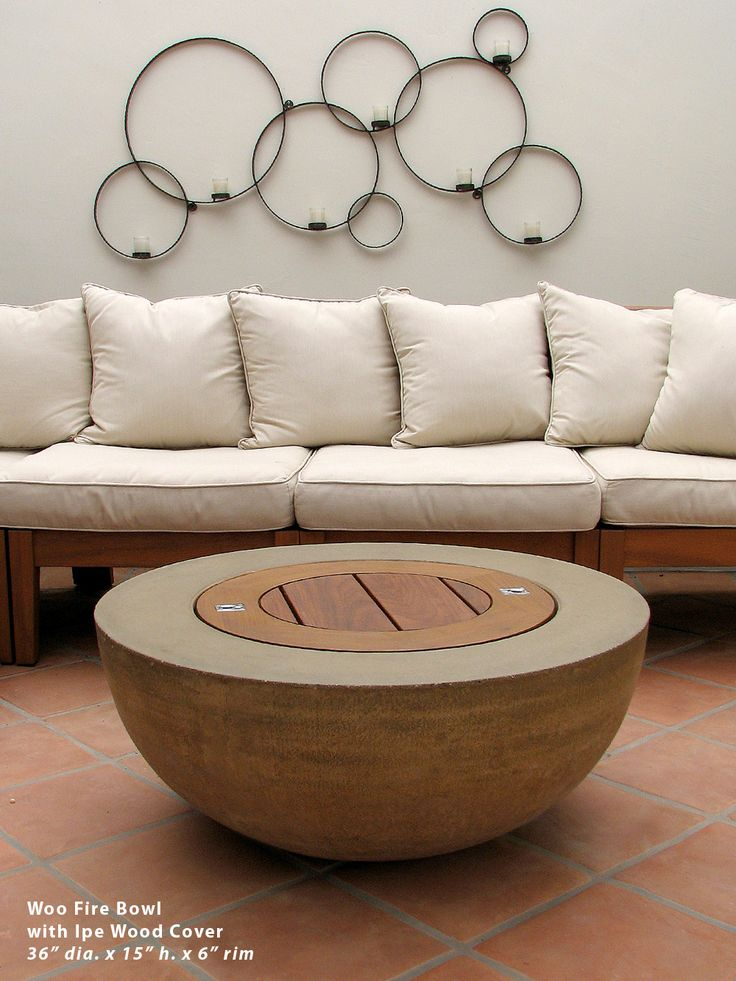 Concrete fire bowl is a table when not in use.