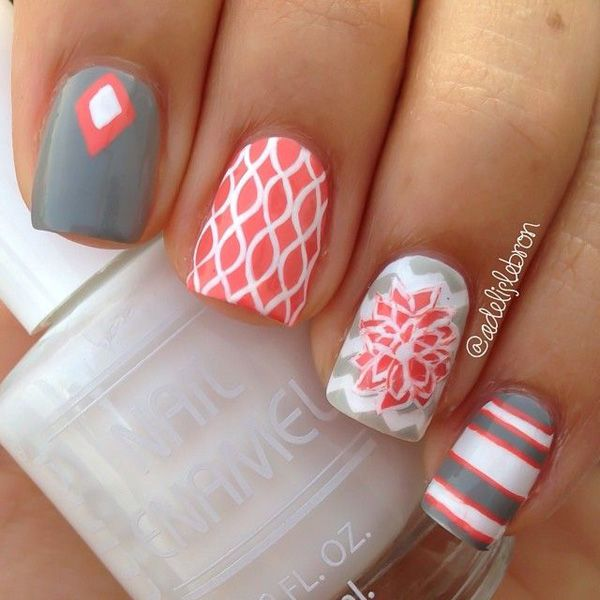 Gray, pink and white nail art design. Paint a variety of designs on your gray nail polish with diamond shapes, floral shapes as well as stripes to give it more life and design.
