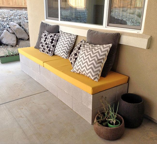 Modern DIY outdoor bench of wood and concrete blocks