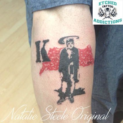 Custom original trash polka inspired Kurt Cobain tattoo by Natalie Steele.