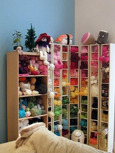 like the tall thin media shelves for yarn stash - this is how I do it, I like to be able to see my yarn