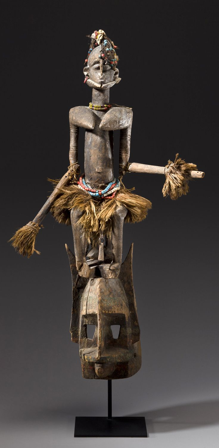 Africa   Mask, with an articulated figure on top, from the Dogon people of Mali   Wood, glass beads, fiber and remains of white pigment