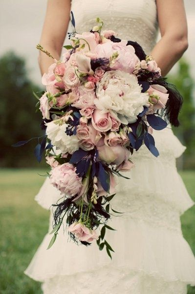 This is the perfect mix. Elegant beautiful flowers with the black accents! I'm in love with this