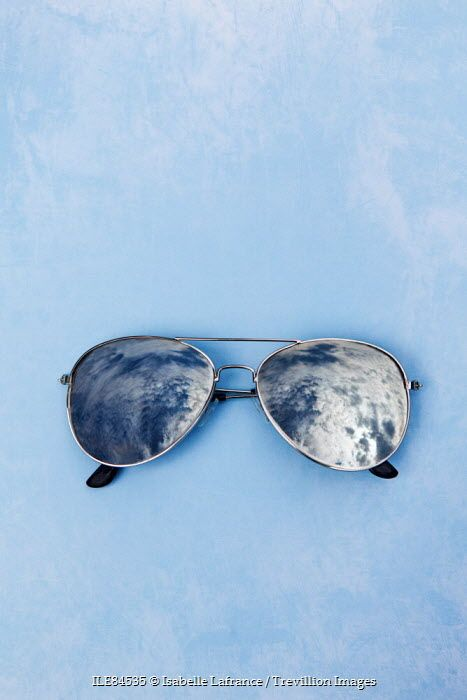 Sky reflected in sunglasses Isabelle Lafrance / Trevillion Images