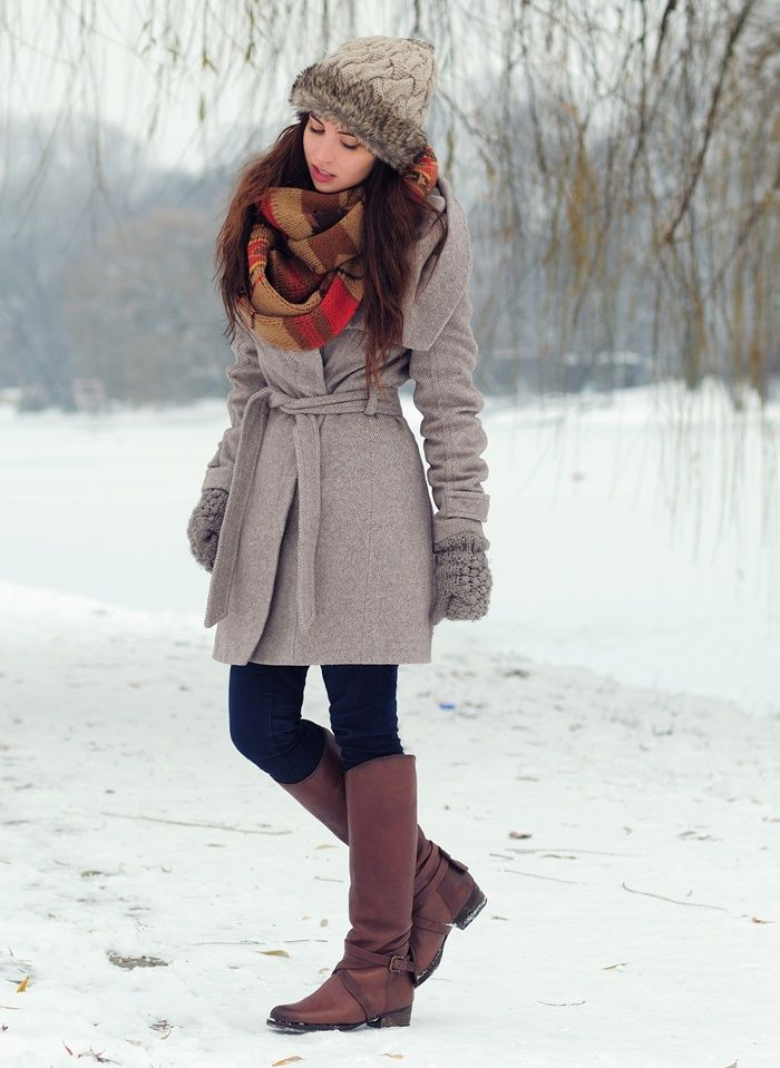 Consider pairing a grey coat with navy blue slim jeans for a comfortable outfit that's also put together nicely. For the maximum chicness make burgundy leather knee high boots your footwear choice.  Shop this look for $178:  http://lookastic.com/women/looks/beanie-scarf-coat-gloves-skinny-jeans-knee-high-boots/7174  — Tan Fur Beanie  — Brown Plaid Scarf  — Grey Coat  — Grey Wool Gloves  — Navy Skinny Jeans  — Burgundy Leather Knee High Boots