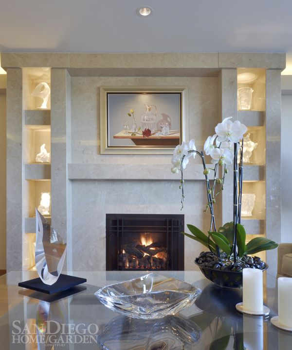 Lit Alcoves Highlight An Exquisite Marble Fireplace In The Living Room Of  This Point Loma Home